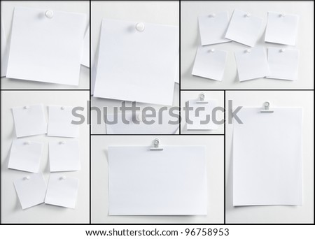 Blank paper, hanging on the wall with a pushpin or forceps