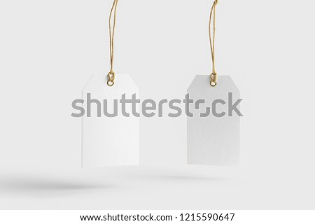 Blank paper label or cloth tags Mock-up isolated on soft gray background.