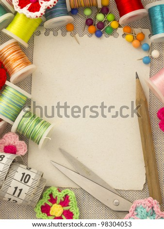 blank paper note in the sewing arrangement