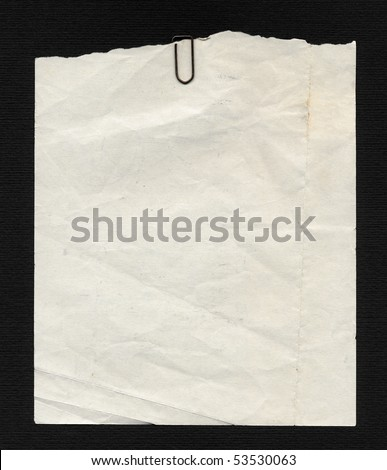 Blank paper page of a note pad - over black background