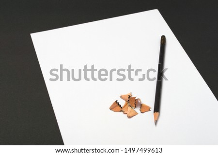 Blank paper pieces and pencil shavings for mock up on a dark background #1497499613