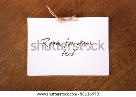 blank paper sheets tied with rope on wooden background