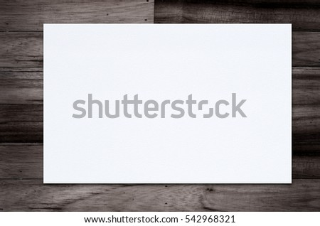 Blank paper texture on wood background. #542968321