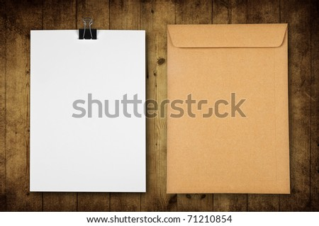 blank paper with envelope on wooden background