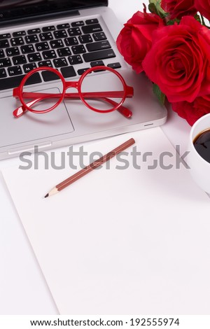 blank paper with laptop, glasses and roses (soft color and vignette filtered)