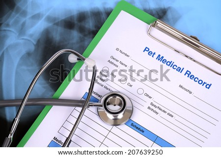 Blank pet medical record and stethoscope.