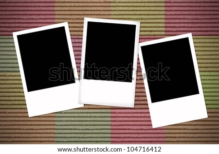 Blank photo frame on color paper background