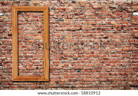 blank photo frame on old brick wall