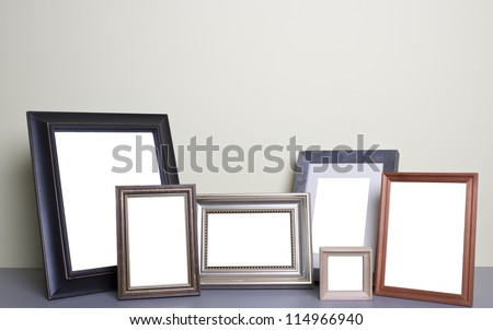 blank photo frames on the table