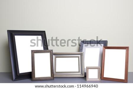 blank photo frames on the table