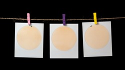 Blank  photo frames with round photo space hanging on a clothesline