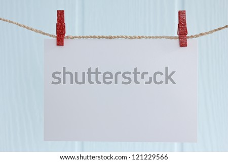 blank photo paper hanging on a rope