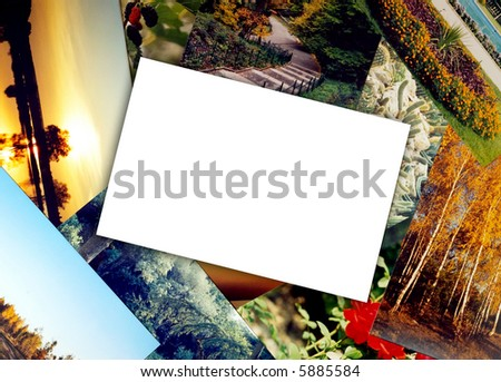 blank photo paper on colorful photos background