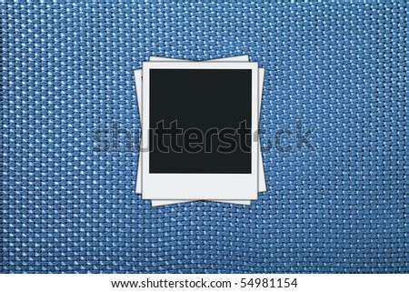 blank photos on blue wicker background