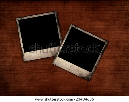 Blank photos on wooden table, vintage background