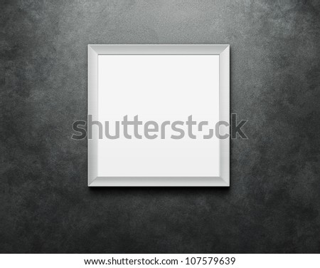 Blank picture frame at the concrete wall with clipping path for the inside