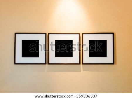 Blank picture frames on the wall room