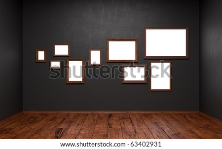 Blank pictures of different sizes in a dark room