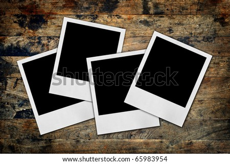 blank picturess on a wood background