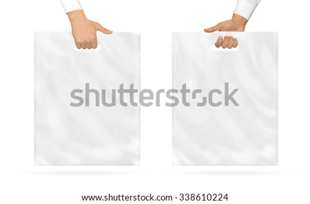 Blank plastic bag mock up holding in hand. Empty polyethylene package mockup hold in hands isolated on white. Pack ready for logo design or mall identity presentation. Food shopping packet handle.