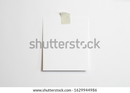 Blank polaroid photo frame with soft shadows  and scotch tape isolated on white paper background as template for graphic designers presentations, portfolios etc.