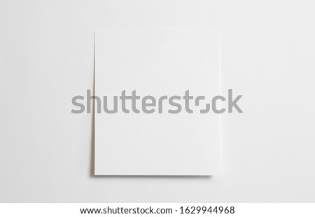 Blank polaroid photo frame with soft shadows isolated on white paper background as template for graphic designers presentations, portfolios etc.