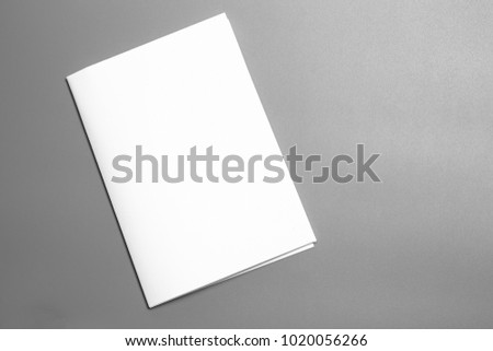 Blank portrait A4. brochure magazine isolated on gray, changeable background / white paper isolated on gray #1020056266