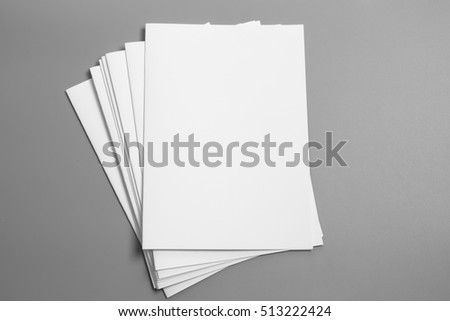 Blank portrait A4. brochure magazine isolated on gray, changeable background / white paper isolated on gray #513222424