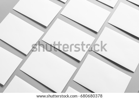 Blank portrait A4. brochure magazine isolated on gray, changeable background / white paper isolated on gray #680680378
