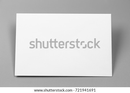 Blank portrait A4. brochure magazine isolated on gray, changeable background / white paper isolated on gray #721941691