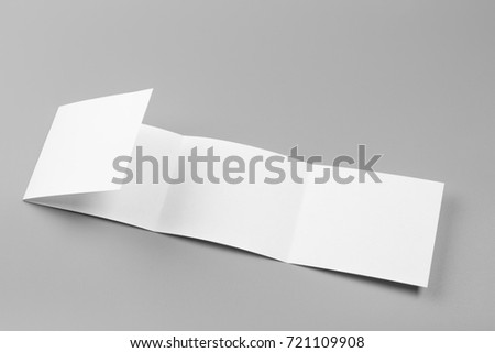 Blank portrait. changeable background / white paper isolated on gray. identity design, corporate templates, company style, set of booklets, blank white folding paper flyer #721109908