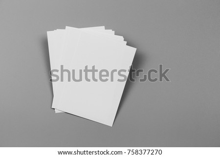 Blank portrait. changeable background / white paper isolated on gray. identity design, corporate templates, company style, set of booklets, blank white folding paper flyer #758377270