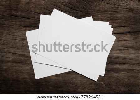 Blank portrait mock-up paper. brochure magazine isolated on brown wooden, changeable background / white paper isolated on wood #778264531