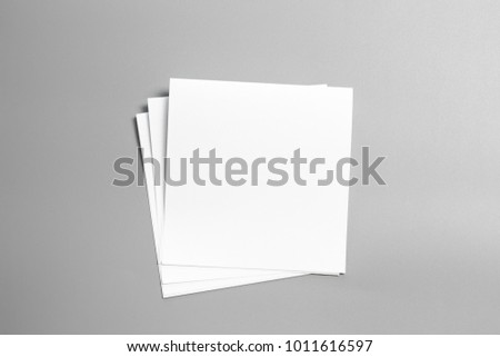 Blank portrait mock-up paper. brochure magazine isolated on gray, changeable background / white paper isolated on gray #1011616597