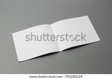 Blank portrait mock-up paper. brochure magazine isolated on gray, changeable background / white paper isolated on gray #790280224