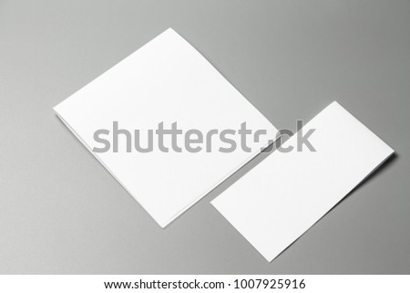 Blank portrait Mock-up paper. changeable background / white paper isolated on gray. identity design, corporate templates, company style, set of booklets, blank white folding paper flyer #1007925916