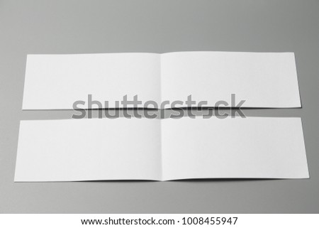 Blank portrait Mock-up paper. changeable background / white paper isolated on gray. identity design, corporate templates, company style, set of booklets, blank white folding paper flyer #1008455947