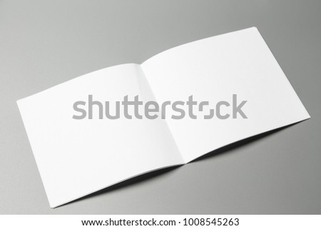 Blank portrait Mock-up paper. changeable background / white paper isolated on gray. identity design, corporate templates, company style, set of booklets, blank white folding paper flyer #1008545263