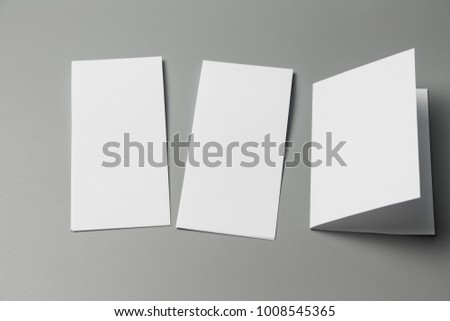 Blank portrait Mock-up paper. changeable background / white paper isolated on gray. identity design, corporate templates, company style, set of booklets, blank white folding paper flyer #1008545365