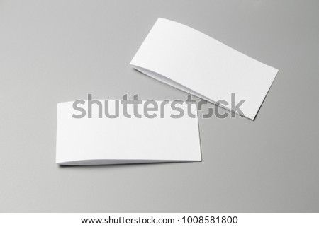 Blank portrait Mock-up paper. changeable background / white paper isolated on gray. identity design, corporate templates, company style, set of booklets, blank white folding paper flyer #1008581800
