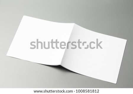 Blank portrait Mock-up paper. changeable background / white paper isolated on gray. identity design, corporate templates, company style, set of booklets, blank white folding paper flyer #1008581812