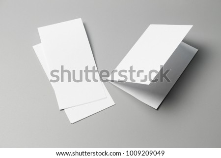 Blank portrait Mock-up paper. changeable background / white paper isolated on gray. identity design, corporate templates, company style, set of booklets, blank white folding paper flyer #1009209049