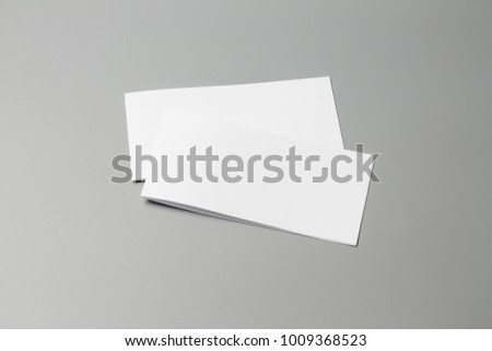 Blank portrait Mock-up paper. changeable background / white paper isolated on gray. identity design, corporate templates, company style, set of booklets, blank white folding paper flyer #1009368523