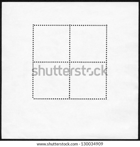 Blank postage stamp block on a black background