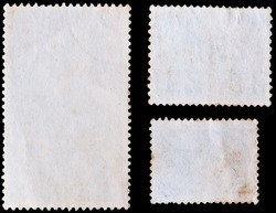 blank postage stamps isolated on black