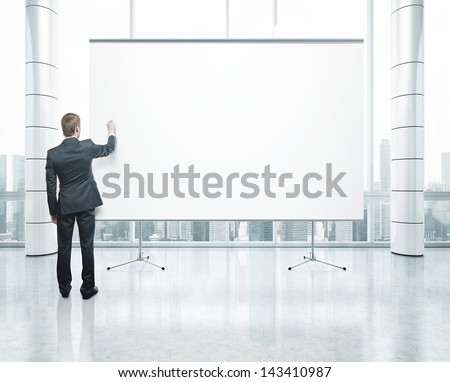 blank poster and drawing businessman