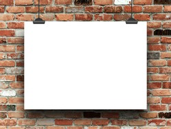 Blank poster frame with clips on multicoloured brick wall background