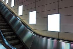 Blank poster mockup in metro station. Big vertical / portrait orientation blank poster with metro escalator background.