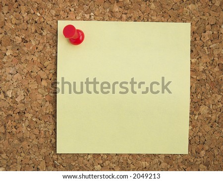 Blank Postit note pinned on cork noticeboard. - stock photo