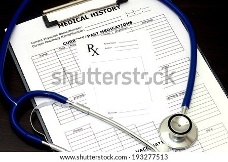 Blank prescription pad with patient medical chart and stethoscope.
